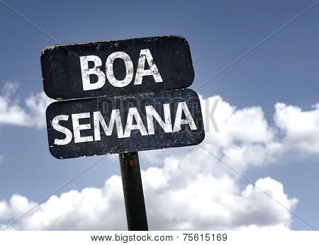 Good Week (In portuguese) sign with clouds and sky background