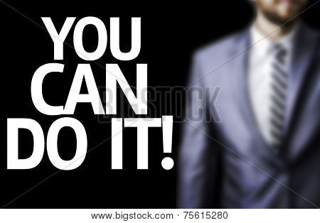 You can Do It! written on a board with a business man on background