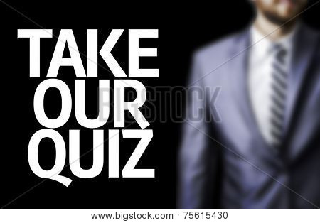 Take Our Quiz written on a board with a business man on background