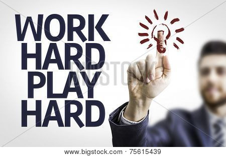 Business man pointing to transparent board with text: Work Hard Play Hard