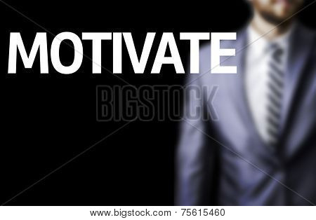 Motivate written on a board with a business man on background