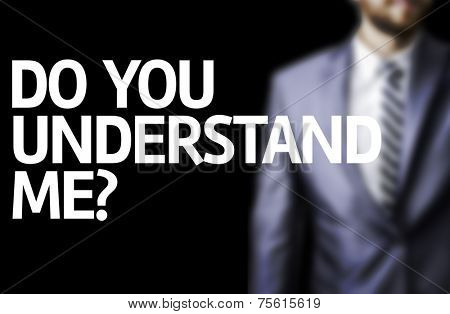 Do You Understand Me? written on a board with a business man on background