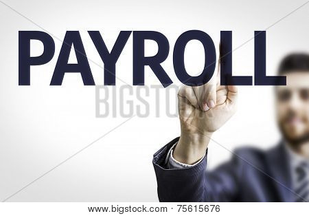 Business man pointing to transparent board with text: Payroll