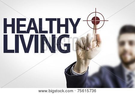 Business man pointing to transparent board with text: Healthy Living