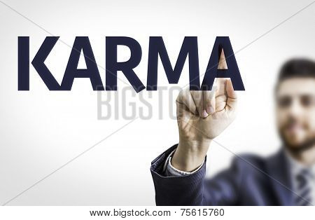 Business man pointing to transparent board with text: Karma