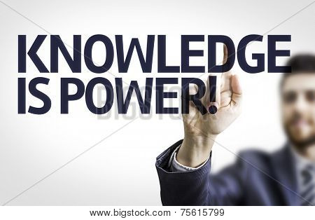 Business man pointing to transparent board with text: Knowledge is Power