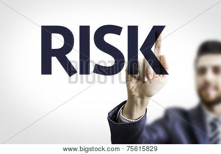 Business man pointing to transparent board with text: Risk