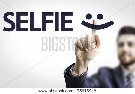 Business man pointing to transparent board with text: Selfie
