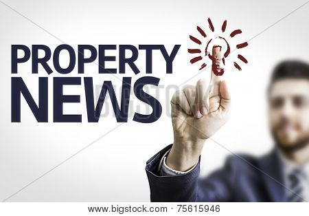 Business man pointing to transparent board with text: Property News