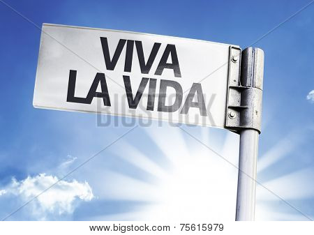 Live your Life (In Spanish) written on the road sign