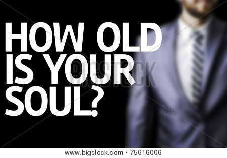 How Old Is Your Soul? written on a board with a business man on background