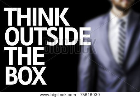 Think Outside The Box written on a board with a business man on background