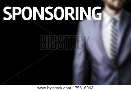 Sponsoring written on a board with a business man on background