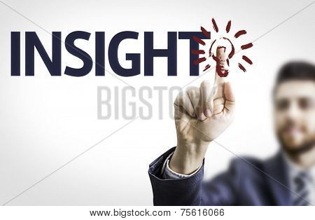 Business man pointing to transparent board with text: Insight