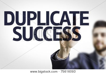 Business man pointing to transparent board with text: Duplicate Success