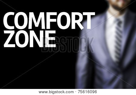 Comfort Zone written on a board with a business man on background