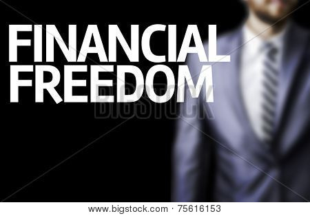 Financial Freedom written on a board with a business man on background