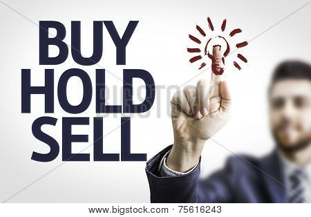 Business man pointing to transparent board with text: Buy Hold Sell