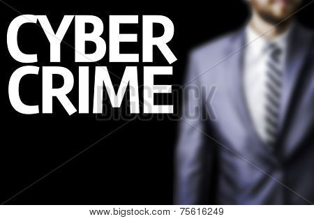 Cyber Crime written on a board with a business man on background