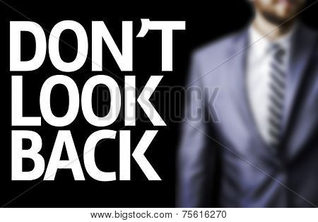 Don't Look Back written on a board with a business man on background