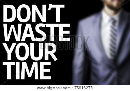 Don't Waste Your Time written on a board with a business man on background