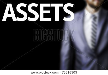 Assets written on a board with a business man on background