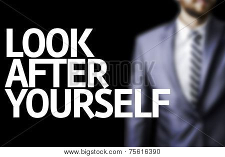 Look After Yourself written on a board with a business man on background