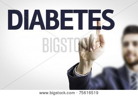 Business man pointing to transparent board with text: Diabetes