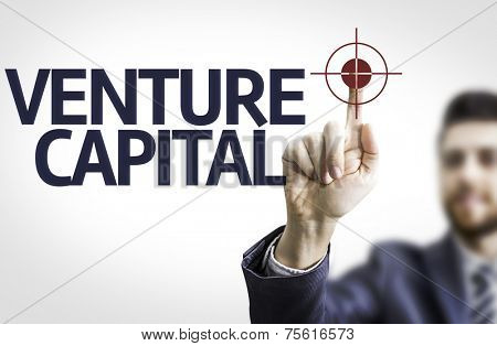 Business man pointing to transparent board with text: Venture Capital