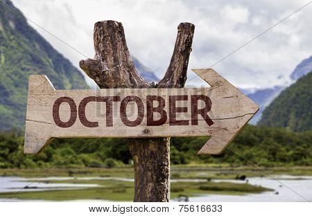October wooden sign with landscape background