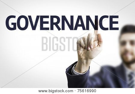 Business man pointing to transparent board with text: Governance