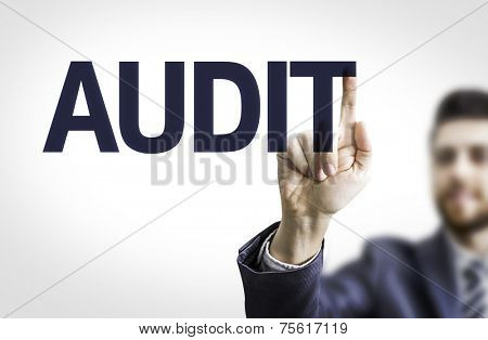 Business man pointing to transparent board with text: Audit