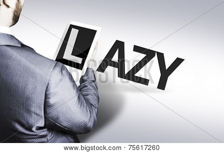 Business man with the text Lazy in a concept image