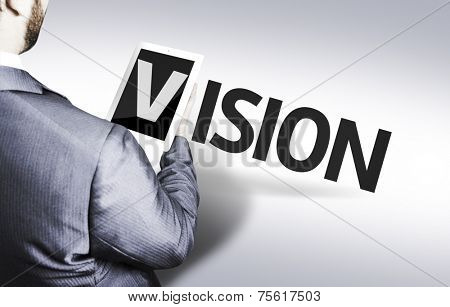 Business man with the text Vision in a concept image
