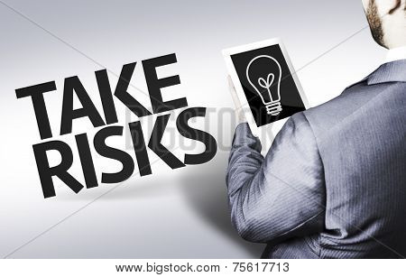 Business man with the text Take Risks in a concept image