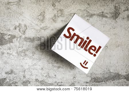 Smile! on Paper Note on texture background