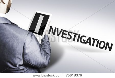 Business man with the text Investigation in a concept image