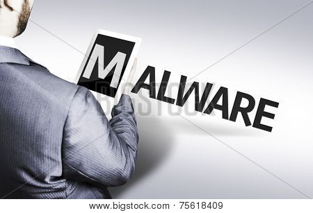 Business man with the text Malware in a concept image