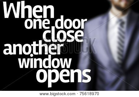 When one door close another window opens written on a board with a business man on background