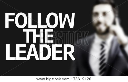Business man with the text Follow the Leader in a concept image