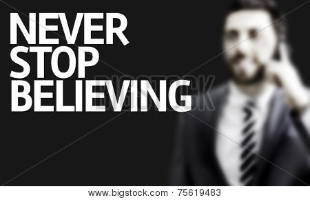 Business man with the text Never Stop Believing in a concept image