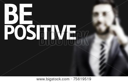 Business man with the text Be Positive in a concept image