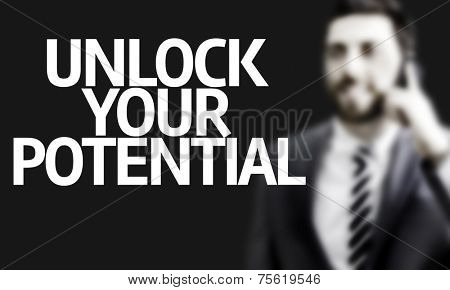Business man with the text Unlock your Potential in a concept image