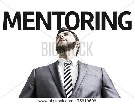 Business man with the text Mentoring in a concept image