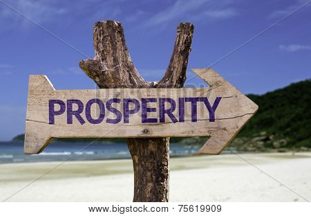 Prosperity wooden sign with a beach on background