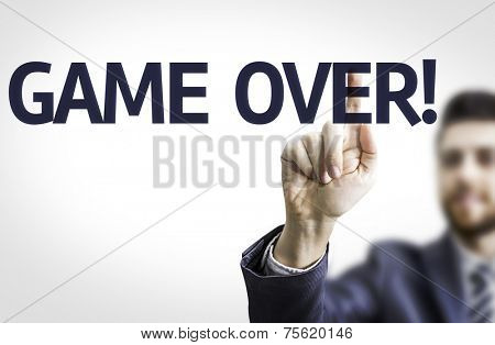 Business man pointing to transparent board with text: Game Over
