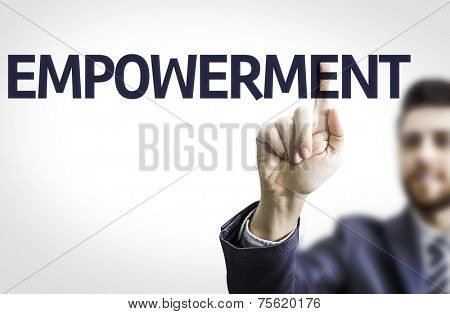 Business man pointing to transparent board with text: Empowerment