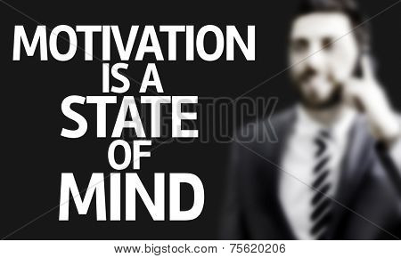 Business man with the text Motivation Is A State of Mind in a concept image