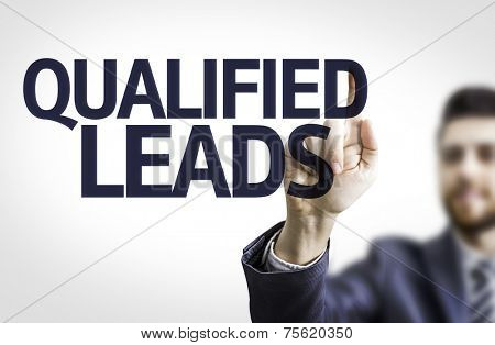 Business man pointing to transparent board with text: Qualified Leads