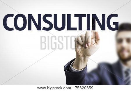 Business man pointing to transparent board with text: Consulting